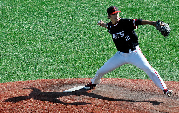 NOC Enid's J.K. Hadlock delivers a pitch during a complete game win against Carl Albert CC Saturday May 14, 2016 during the Region 2 District tournament at David Allen Ballpark. (Billy Hefton / Enid News & Eagle)