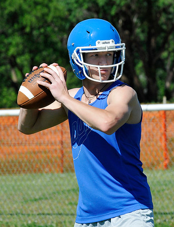 Hunter Lovell of Waukomis throws a pass during spring football practice Tuesday May 10, 2016. (Billy Hefton / Enid News & Eagle)