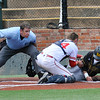 Home plate umpire, Patrick Griffin, gets a close look at Sinclair catcher, Hunter Losekamp, tagging out Monroe CC's Luke Brust at home plate during the NJCAA DII World Series at David Allen Ballpark in Enid Sunday May 29, 2016. (Billy Hefton / Enid News & Eagle)