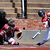 NOC Enid's Justin Brown gets a base hit against Redlands CC Friday May 13, 2016 during the Region 2 District tournament at David Allen Ballpark. (Billy Hefton / Enid News & Eagle)