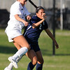 Enid's Marybel Garcia challenges for the ball with Union's Victoria Redden during the first round of state playoffs at the Union soccer stadium in Tulsa Tuesday May 3, 2016. (Billy Hefton / Enid News & Eagle)