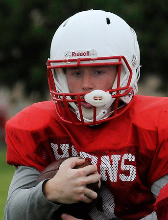 Chisholm's Connor Pasby goes through drills during spring practice Tuesday May 17, 2016. (Billy Hefton / Enid News & Eagle)