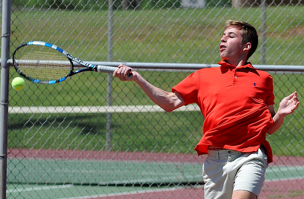 Enid's Ryan Leap returns a shot during practice Wednesday May 11, 2016 at the 9th Street courts. (Billy Hefton / Enid News & Eagle)