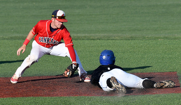 Kankakee's Alex Mandeville tags out Pitt CC's Daniel Millwee at second during an elimination game in the 2017 NJCAA DII World Series at David Allen Memorial Ballpark Tuesday May 30, 2017. (Billy Hefton / Enid News & Eagle)