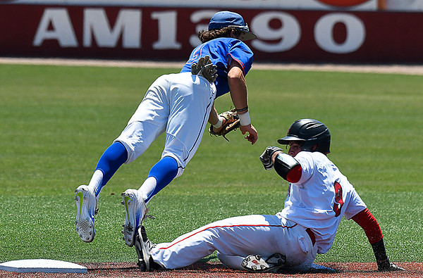 NOC Enid's Daniel Davila slides into second under a diving Ryan Harrel of Murray State during the Region 2 tournament Monday May 15, 2017 at David Allen Memorial Ballpark. (Billy Hefton / Enid News & Eagle)