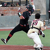 NOC Enid's Matt Conerly avoids the tag of Redlands catcher, Michael Oyervides, to score during the Region 2 tournament Saturday May 13, 2017 at David Allen Memorial Ballpark. (Billy Hefton / Enid News & Eagle)