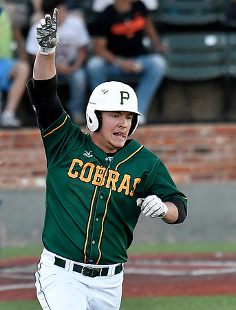 Parkland's Zach Pych celebrates a homerun against Pitt CC as he rounds first baseduring the 2017 NJCAA DII World Series at David Allen Memorial Ballpark Monday May 29, 2017. (Billy Hefton / Enid News & Eagle)