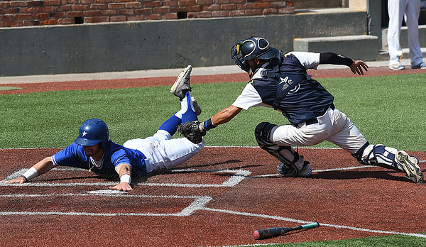 Lansing CC's Drew Stavischeck beats the tag of Phoenix CC's Jared Nelson to score during an elimination game in the 2017 NJCAA DII World Series at David Allen Memorial Ballpark Tuesday May 30, 2017. (Billy Hefton / Enid News & Eagle)