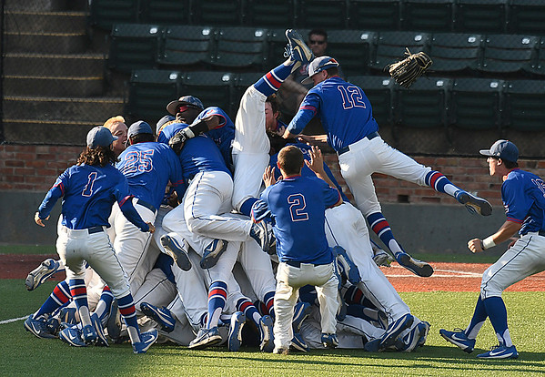 Murray State players celebrate winning the Region 2 tournament Monday May 15, 2017 at David Allen Memorial Ballpark. (Billy Hefton / Enid News & Eagle)