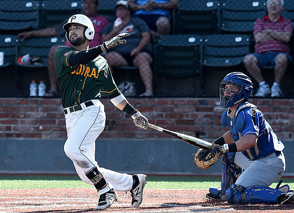 Parkland's Fahd Shakeel hits a 3-run homerun against Pitt CC during the 2017 NJCAA DII World Series at David Allen Memorial Ballpark Monday May 29, 2017. (Billy Hefton / Enid News & Eagle)
