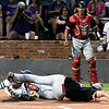 LSU Eunice's Brent Hebert takes a foot to the head from NOC Enid's Hayden Parker as he tries to score Wednesday May 30, 2018 during the NJCAA DII World Series at David Allen Memorial Ballpark. (Billy Hefton / Enid News & Eagle)