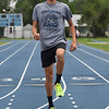 Ruben Daniels warms up on the Enid High track Tuesday May 8, 2018. (Billy Hefton / Enid News & Eagle)