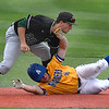 Oklahoma Baptist University's Brett Bloomfield tags out Southern Arkansas' Dakota Wright Tuesday May 8, 2018 during the Great American Conference tournament at David Allen Memorial Ballpark. (Billy Hefton / Enid News & Eagle)