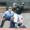 Oklahoma Baptist University's P.J. Harris hits a RBI double against Southern Arkansas Tuesday May 8, 2018 during the Great American Conference tournament at David Allen Memorial Ballpark. (Billy Hefton / Enid News & Eagle)