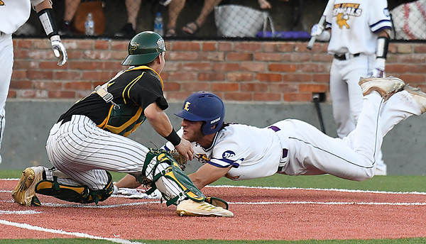 Parkland CC's Bobby Barnard tags out LSU Eunice's Koi Westbrook at home plate during the NJCAA DII World Series Thursday May 31, 2018 at David Allen Memorial Ballpark. (Billy Hefton / Enid News & Eagle)