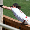 NOC Enid's Brendon Woelfie reaches over the wall to catch a foul ball against Western CC Thursday May 3, 2018. (Billy Hefton / Enid News & Eagle)