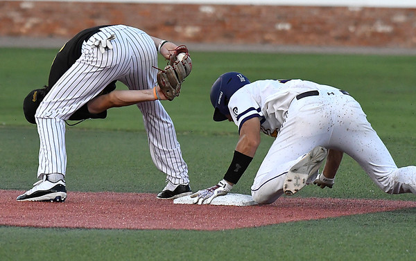 Parkland CC's Trevor Minder reaches between his legs attempting to tag LSU Eunices's Jacob Richard at second base during the NJCAA DII World Series Thursday May 31, 2018 at David Allen Memorial Ballpark. (Billy Hefton / Enid News & Eagle)