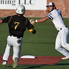 LSUE's Koi Westbrook throws to first for a doubleplay over Parkland CC's Trystin Raikes Thursday May 31, 2018 at David Allen Memorial Ballpark. (Billy Hefton / Enid News & Eagle)