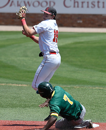 NOC Enid's Tyler Wood gets a force out on Western CC's Junior Martinez during the opening game of the Region 2 tournament at David Allen Memorial Ballpark Thursday May 10, 2018. (Billy Hefton / Enid News & Eagle)