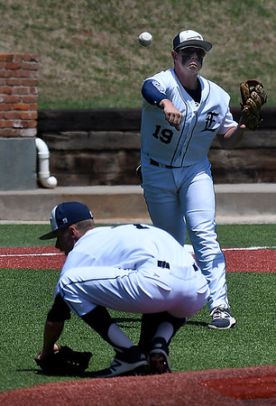 Enid's Colby Jarnagin throws to first over Koby Hudson against Ponca City during a class 6A regional at David Allen Memorial Ballpark Thursday May 3, 2018. (Billy Hefton / Enid News & Eagle)
