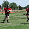 OBA defensive players run to the ball during spring practice at Oklahoma Bible Academy Tuesday May 15, 2018. (Billy Hefton / Enid News & Eagle)