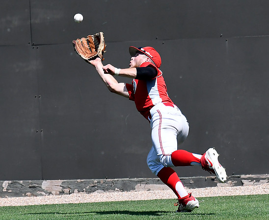 Sinclair CC's Sean Darmafall makes a running catch in deep centerfield against Brunswick CC Monday May 28, 2018 during the NJCAA DII World Series at David Allen Memorial Ballpark. (Billy Hefton / Enid News & Eagle)
