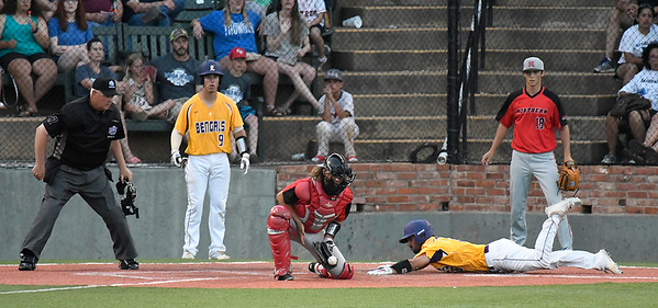 LSU Eunice's Bren Faulk slides into home as the ball bounces to NOC's Dylan Caplinger Monday May 28, 2018 during the NJCAA DII World Series at David Allen Memorial Ballpark. (Billy Hefton / Enid News & Eagle)
