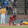 LSU Eunice's Bren Faulk slides into home as the ball bounces to NOC's Dylan Caplinger Monday May 28, 2018 during the NJCAA DII World Series at David Allen Memorial Ballpark. (Billy Hefton / Enid News & Eagle)