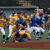 Members of the Southern Arkansas University baseball team rush the field to celebrate winning the Great American Conference tournament championship Tuesday May 8, 2018 at David Allen Memorial Ballpark. The Muleriders defeated Oklahoma Baptist University 16-3 in the final game to win the championship. (Billy Hefton / Enid News & Eagle)