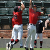 NOC Enid's Tyler Wood and D.J. Calvert celebrate the Jets' 10-6 over Sinclair CC in an elimination game during the NJCAA DII World Series Wednesday May 30, 2018 at David Allen Memorial Ballpark. (Billy Hefton / Enid News & Eagle)