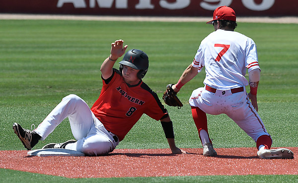 NOC Enid's Wesley O'Neill slides pass the tag of Sinclair CC's Colin Shepherd in an elimination game during the NJCAA DII World Series Wednesday May 30, 2018 at David Allen Memorial Ballpark. (Billy Hefton / Enid News & Eagle)
