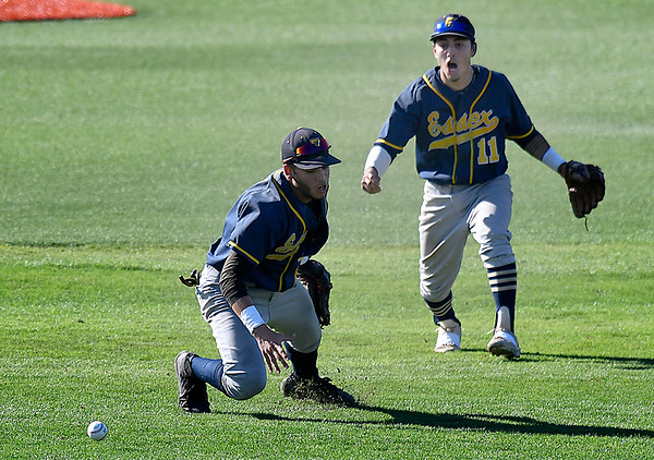 CCBC Essex's Julio Creazzola (11) reacts as Nelson Laviosa misplays the ball allowing Parkland CC to score the winning runs in the bottom of the 9th inning Sunday May 27, 2018 during the NJCAA DII World Series at David Allen Memorial Ballpark. (Billy Hefton / Enid News & Eagle)