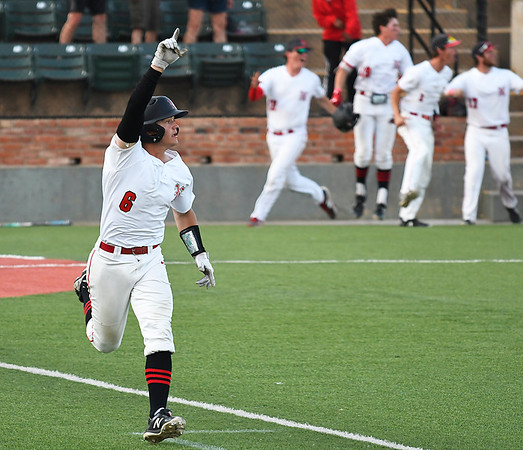 NOC Enid's Brendon Woelfle circles the bases with a raised finger as team mates leap out of the dugout after Woelfle's walkoff home run in the 10th inning against Western to win the Region 2 tournament championship Sunday May 13, 2018 at David Allen Memorial Ballpark. (Billy Hefton / Enid News & Eagle)