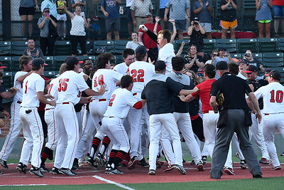 NOC Enid's Brendon Woelfle (center) is surrounded by team mates as he leaps onto home plate after hitting a walkoff home run in the 10th inning against Western to win the Region 2 tournament championship Sunday May 13, 2018 at David Allen Memorial Ballpark. (Billy Hefton / Enid News & Eagle)