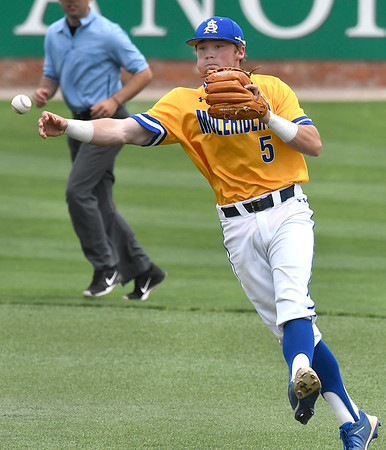 Southern Arkansas' Austin Baker makes a throw to first against Oklahoma Baptist University Tuesday May 8, 2018 during the Great American Conference tournament at David Allen Memorial Ballpark. (Billy Hefton / Enid News & Eagle)