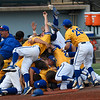 Members of the Southern Arkansas University baseball team celebrate winning the Great American Conference tournament championship Tuesday May 8, 2018 at David Allen Memorial Ballpark. The Muleriders defeated Oklahoma Baptist University 16-3 in the final game to win the championship. (Billy Hefton / Enid News & Eagle)