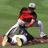 NOC Enid's D.J. Calvert tags out Redlands CC's Tyler Hawk during the Region 2 tournament at David Allen Memorial Ballpark Friday May 11, 2018. (Billy Hefton / Enid News & Eagle)