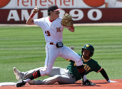 NOC Enid's Tyler Wood avoids Western CC's Matthew Golda to complete a doubleplay in the opening game of the Region 2 tournament at David Allen Memorial Ballpark Thursday May 10, 2018. (Billy Hefton / Enid News & Eagle)