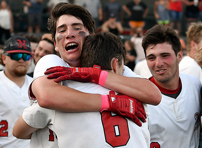 NOC Enid's Brendon Woelfle (6) is hugged by Tyler Wood after hitting a walkoff home run in the 10th inning against Western to win the Region 2 tournament championship Sunday May 13, 2018 at David Allen Memorial Ballpark. (Billy Hefton / Enid News & Eagle)
