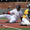 NOC Enid's E.J. Taylor scores behind Western's Allan Berrios during the first game of the Region 2 tournament championship Sunday May 13, 2018 at David Allen Memorial Ballpark. (Billy Hefton / Enid News & Eagle)