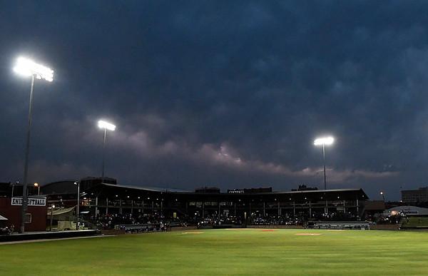 A streak of lightning lights up the clouds over David Allen Memorial Ballpark Tuesday May 29, 2018. (Billy Hefton / Enid News & Eagle)