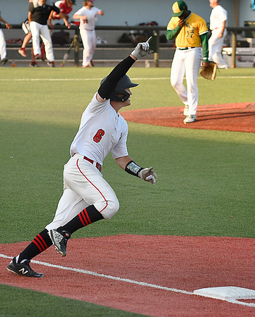 NOC Enid's Brendon Woelfle circles the bases with a raised finger as Western Oklahoma pitcher, Avelito Feliz, leaves the mound. Woelfle hit a walkoff homerun in the bottom to the 10th inning to win the Region 2 tournament championship Sunday May 13, 2018 at David Allen Memorial Ballpark. (Billy Hefton / Enid News & Eagle)