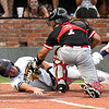 LSU Eunice's Mason Templet scores under the tag of NOC Enid's Dylan Caplinger Wednesday May 30, 2018 during the NJCAA DII World Series at David Allen Memorial Ballpark. (Billy Hefton / Enid News & Eagle)