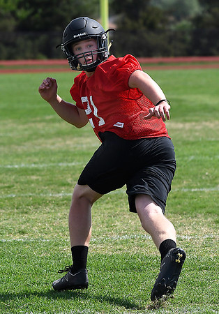 OBA's Caleb Spann drops into coverage during spring practice at Oklahoma Bible Academy Tuesday May 15, 2018. (Billy Hefton / Enid News & Eagle)