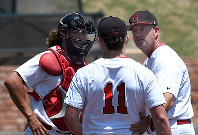 NOC Enid head coach, Raydon Leaton and catcher, Dylan Caplinger visit with pitcher, Braxton Douthit during the opening game of the Region 2 tournament at David Allen Memorial Ballpark Thursday May 10, 2018. (Billy Hefton / Enid News & Eagle)