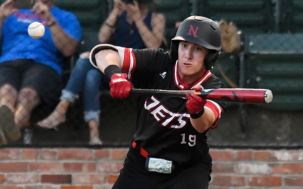 NOC Enid's Tyler Wood reaches up to lay down a sacrifice bunt against Murray State during the Region 2 tournament Saturday May 12, 2018 at David Allen Memorial Ballpark. (Billy Hefton / Enid News & Eagle)