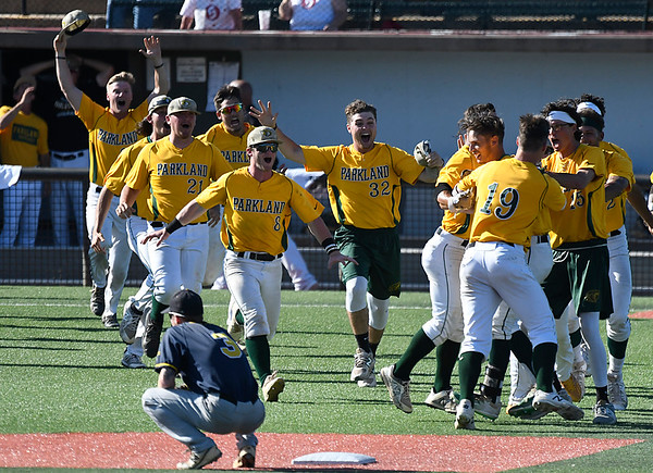 Parkland CC players rush to celebrate Cristian Sanchez's game winning hit in the bottom of the 9th inning against CCBC Essex Sunday May 27, 2018 during the NJCAA DII World Series at David Allen Memorial Ballpark. (Billy Hefton / Enid News & Eagle)