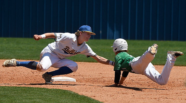 Drummond's Seth Gray tags out Leedy's Aiden Page during the Bulldog's 2-1 loss in the class B state championship game Saturday May 5, 2018 in Oklahoma City. (Billy Hefton / Enid News & Eagle)