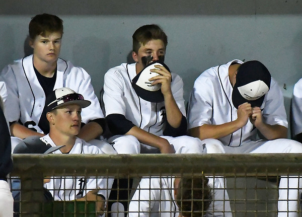 Members of th eEnid High School baseball team sit in the dugout following a 5-0 loss to Union in a class 6A regional tournament ending their season at David ALlen Memorial Ballpark Thursday May 3, 2018. (Billy Hefton / Enid News & Eagle)