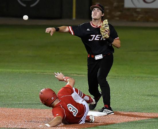 NOC Enid's Tyler Wood throws over Sinclair CC's Sean Darmafall during the NJCAA DII World Series Saturday May 26, 2018 at David Allen Memorial Ballpark. (Billy Hefton / Enid News & Eagle)